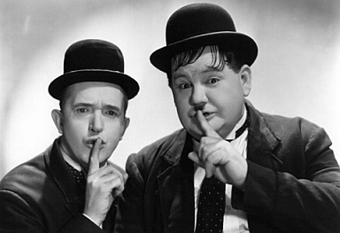 Laurel and Hardy making shush faces