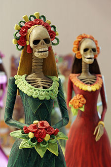 A picture of skeleton-looking catrina dolls, which are popular figures of the Day of the Dead celebrations in Mexico