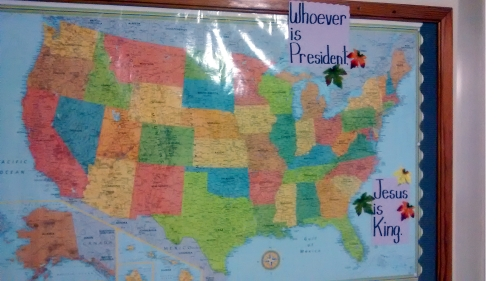 Picture of school bulletin board showing US map and saying Whoever is President, Jesus is King.
